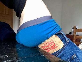 Sagging in Levi jean shorts in kitchen